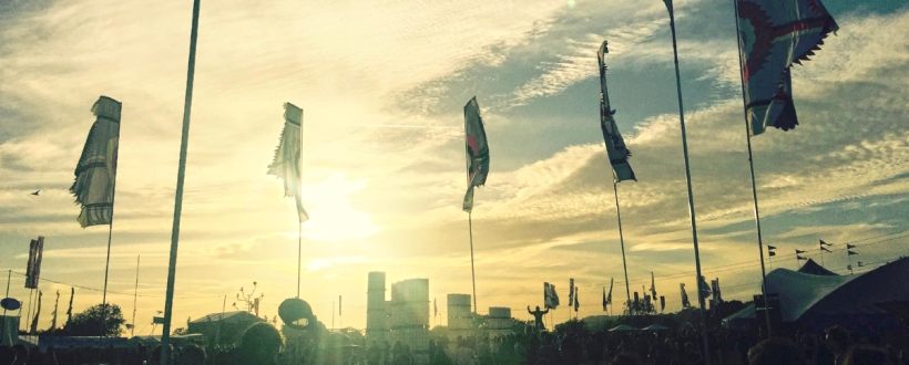 Sunset over Glastonbury festival Silver Hayes with flags