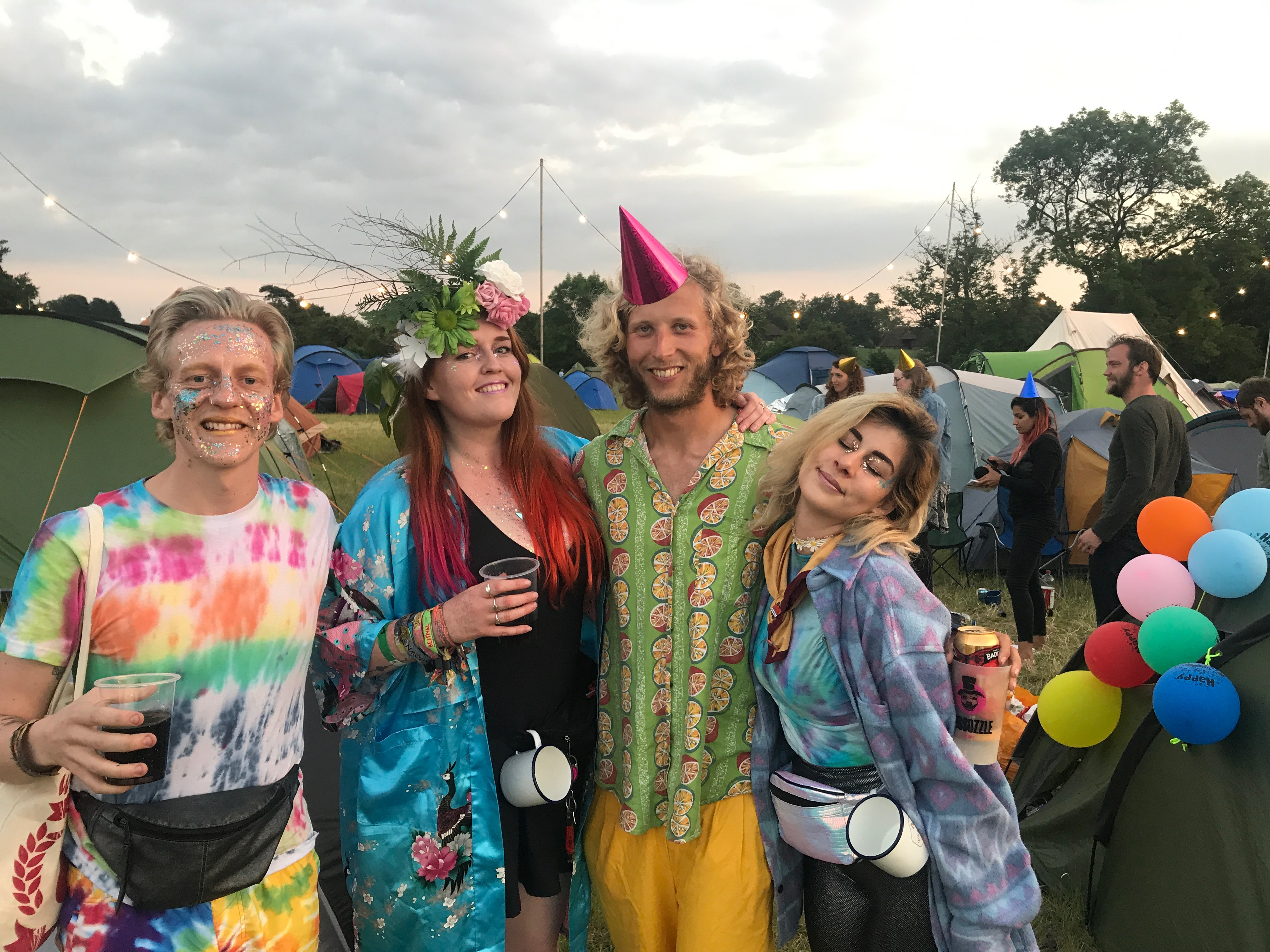 The gang looking super festival in tie dye, natural headpieces, glitter, party hats and with our Wildfire mugs attached to our belts.