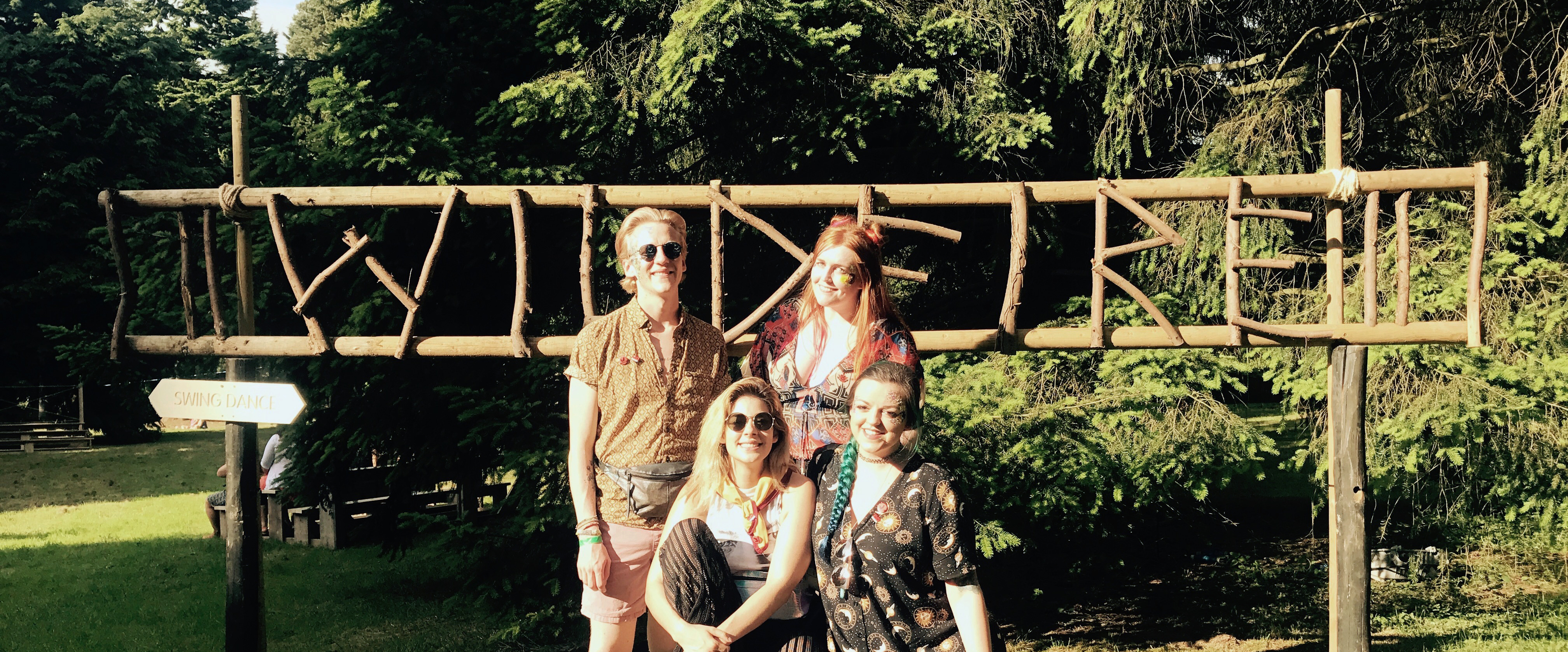 My friends and I in front of the wooden Wildfire sign