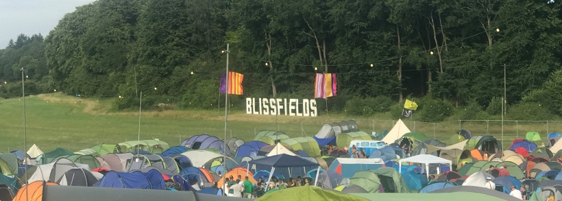 The Blissfields sign at the back of the camping field welcoming us tents