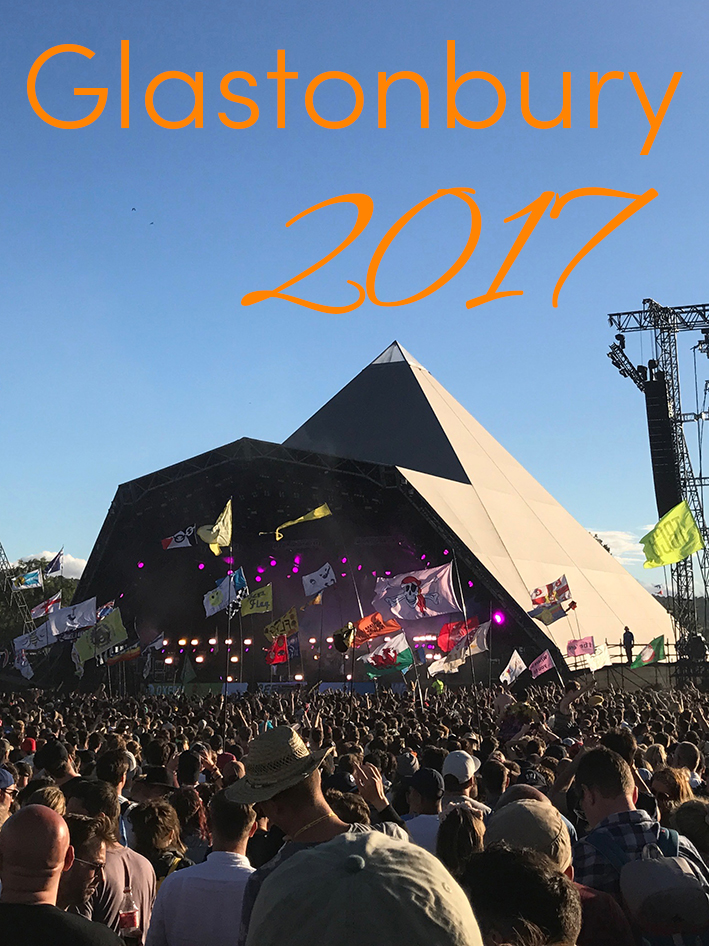 Pinterest share image - blue skies over the flags and Pyramid Stage with blog title