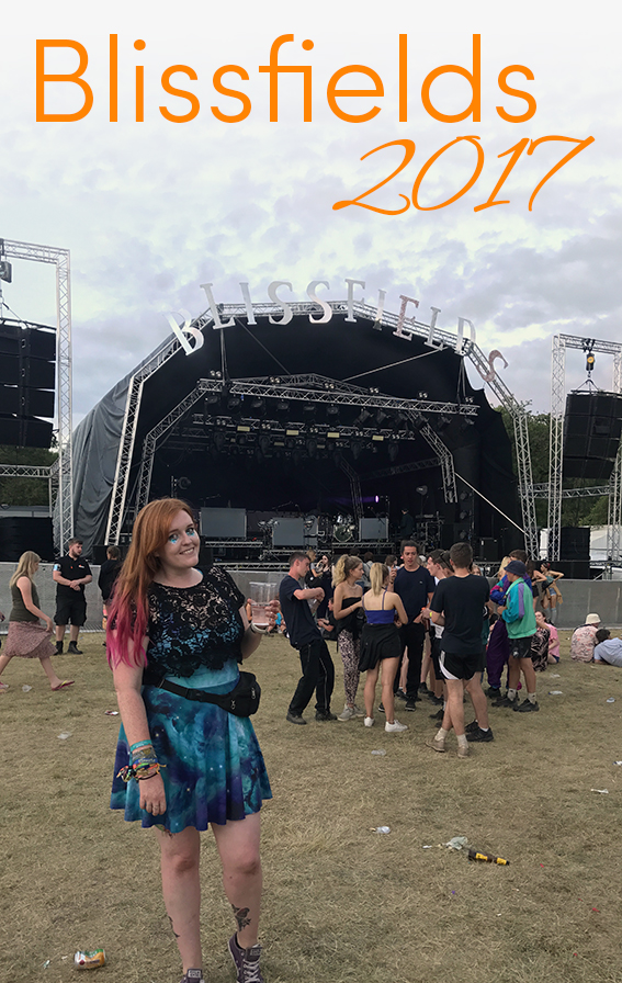 Pinterest share image - Me in front of the main stage in a blue galaxy dress at Blissfields with blog title