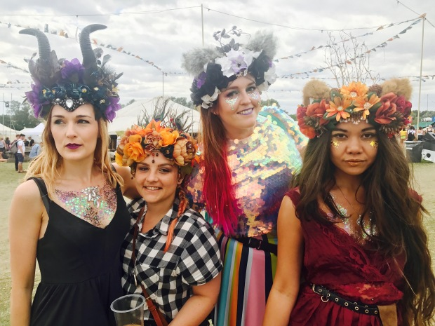 My three best friends and I all dressed up wearing glitter and Headspace Headdresses