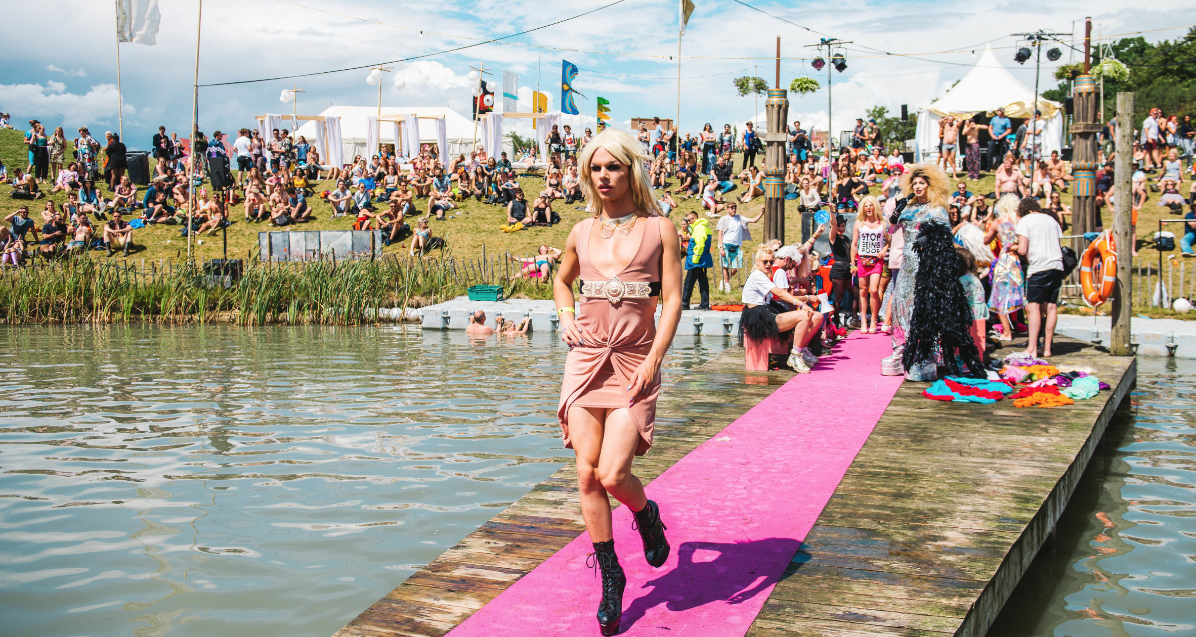 SGP's Next Top Model competition features men in drag strutting up the catwalk over the lake.