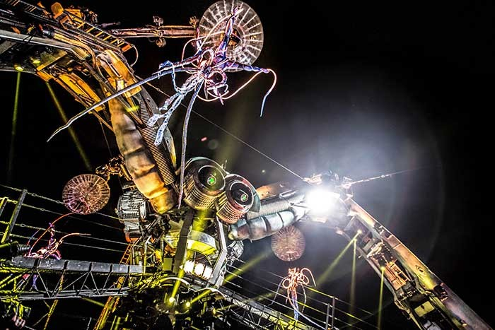 Dangling illuminated jellyfish humans from the spider of Arcadia Spectacular