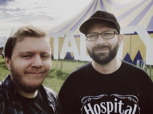 Matt and George in front of the Hospitality sign at HITP