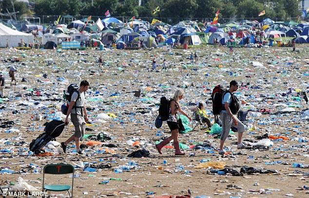 Revellers leaving Glastonbury amongst piles of waste
