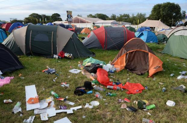 Discarded tents and rubbish at Glastonbury festival