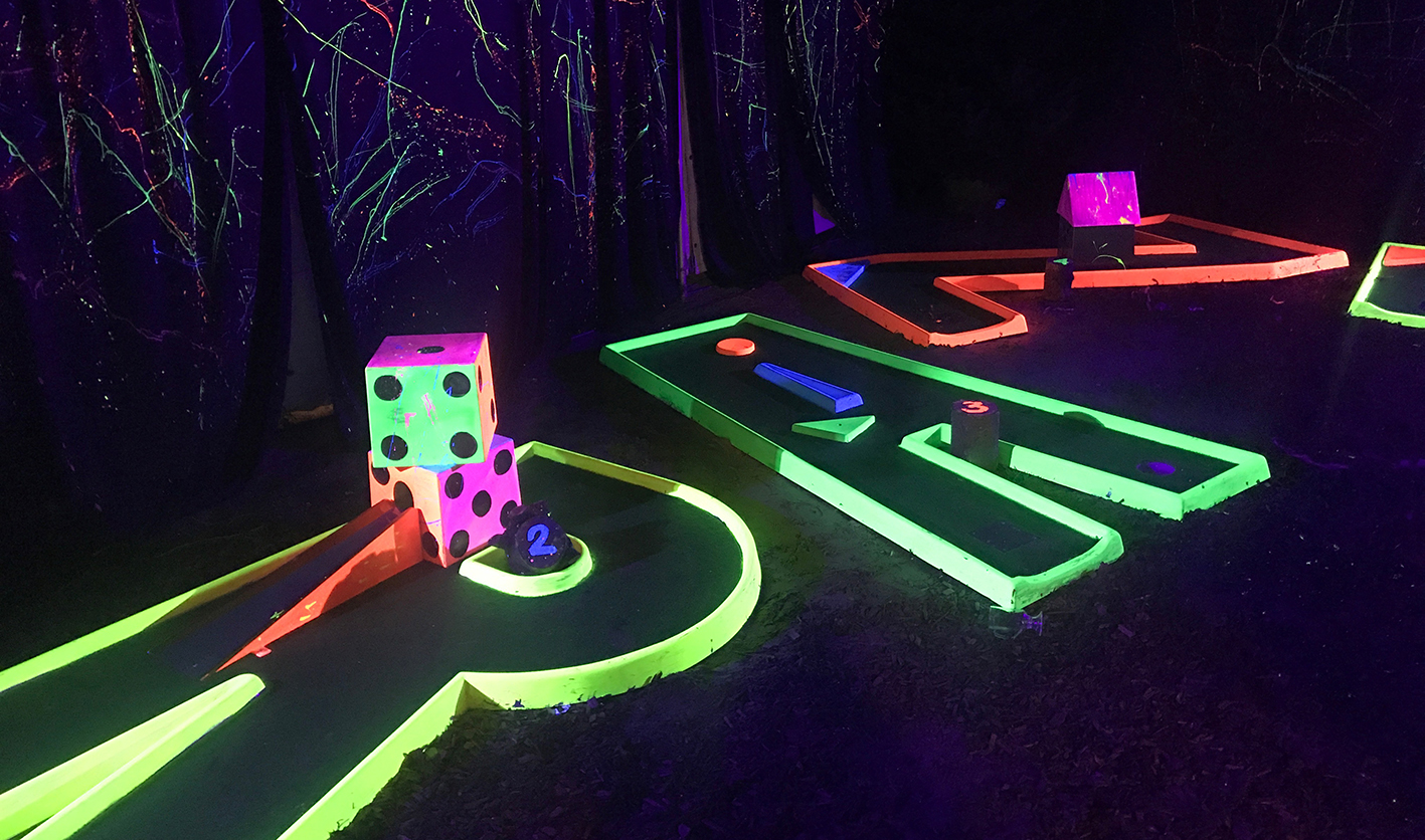 Neon day glow crazy golf fun activities at Winterland in Fulham