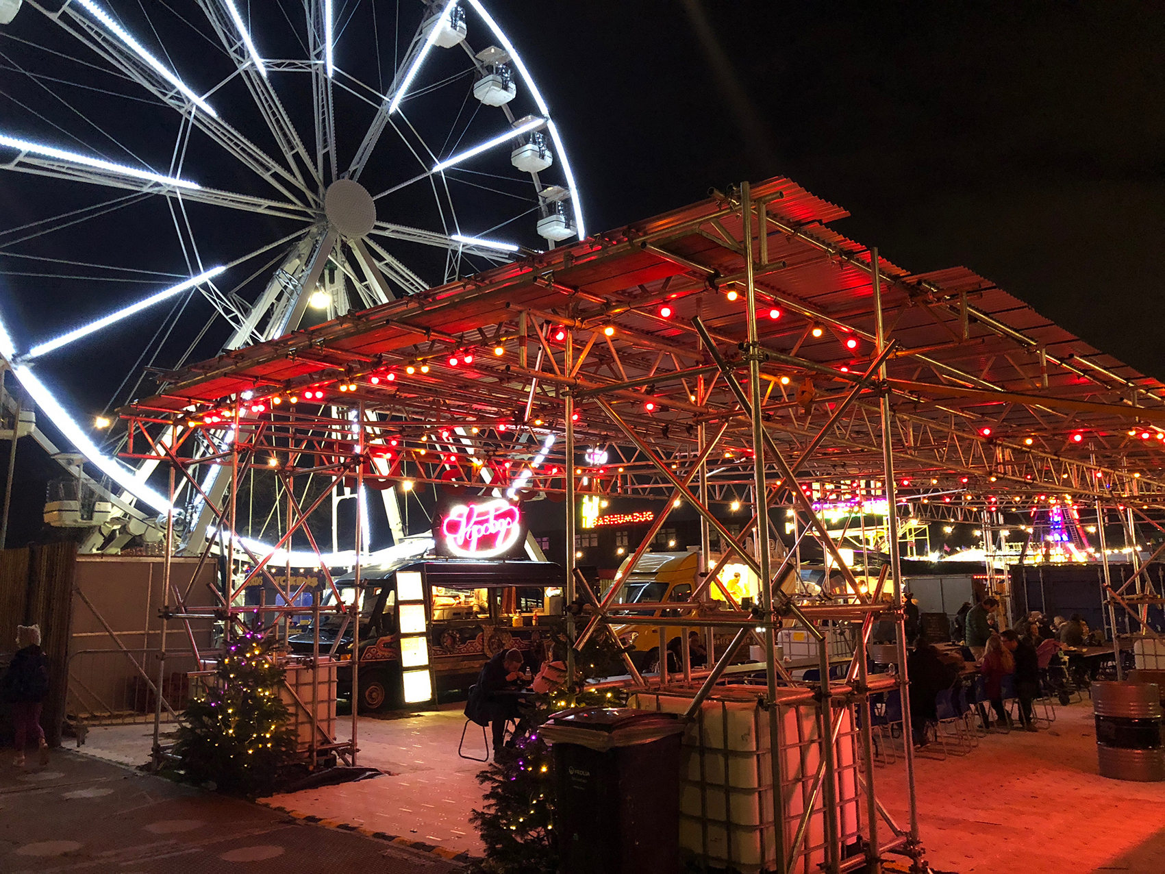 The Truck Stop area curated by Street Feast at Winterville, 5 food trucks overlooked by the Big Wheel