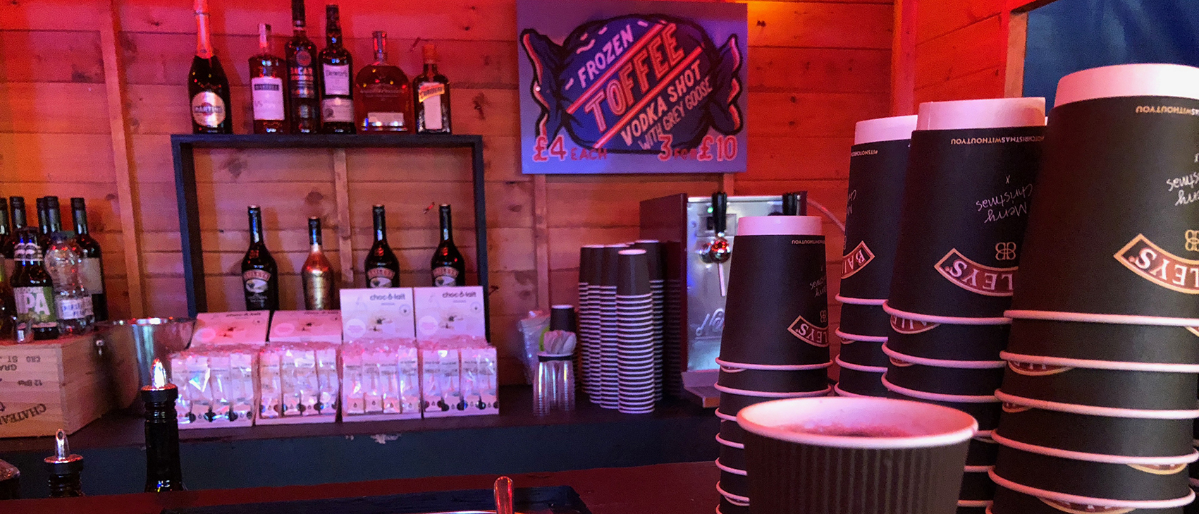 One of the smaller bar cabins dotted around the site selling mulled wine, boozy hot chocolates and frozen toffee vodka shots.
