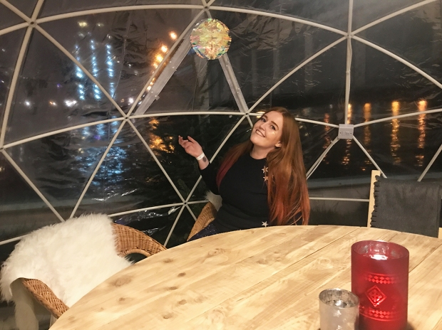 Sat inside the igloos nice and toasty with fur covered seating and great views, London Christmas festival
